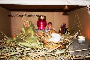 Вертеп с ребенком на Рождество