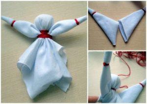 С помощью ниток фиксируют на груди куколки