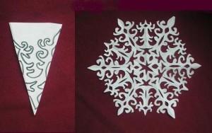 вырезанием снежинку из бумаги